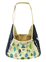 Denim Leaf Pet Sling - A very casual but practical pet sling! The Denim Leaf sling is especially designed to help you look fabulous and make your pet's journey as comfortable and as safe as possible. It has a mesh opening at the top of the bag to provide ventilation and make it possible for your pet to take in the view du...